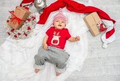 圣诞节女婴在圣诞节的前夕六个月 图库摄影