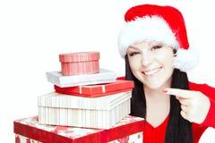 圣诞节妇女在白色的藏品存在 免版税库存图片