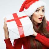 圣诞节妇女,圣诞老人帽子画象 配件箱礼品查出的白色 库存图片