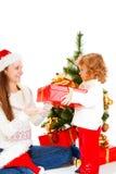 圣诞节妈妈存在 免版税库存图片
