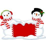 圣诞节委员会和两个雪人 免版税库存照片