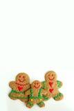 圣诞节姜饼在白色背景隔绝的曲奇饼家庭 免版税库存图片