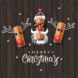 圣诞节字符、圣诞老人和驯鹿 免版税库存照片