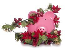 圣诞节存钱罐的费用 免版税库存照片