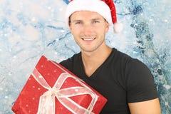 圣诞节季节-英俊白肤金发人微笑 库存图片