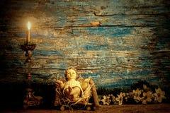 圣诞节宗教卡片,他的小儿床的小耶稣 免版税库存照片