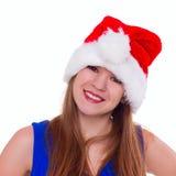 圣诞节帽子的传神情感女孩在白色背景 免版税库存图片