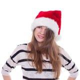 圣诞节帽子的传神情感女孩在白色背景 库存图片