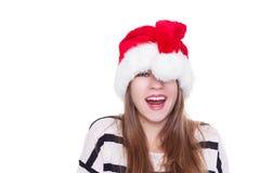 圣诞节帽子的传神情感女孩在白色背景 库存照片