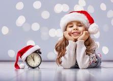 圣诞节帽子的孩子 图库摄影