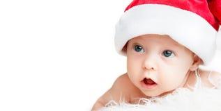 圣诞节帽子的新出生的婴孩 免版税库存照片