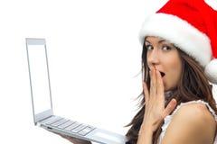 圣诞节帽子膝上型计算机笔记本妇女 免版税库存照片