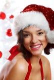 圣诞节微笑的妇女 免版税库存照片