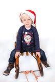 圣诞节心情的逗人喜爱的男孩 图库摄影