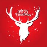 圣诞节快活的明信片 在红色背景的白色鹿剪影 雪 图库摄影