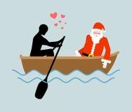 圣诞节恋人 人和圣诞老人和乘驾在小船 恋人  免版税库存照片