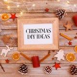 圣诞节想法在圣诞节舱内甲板位置的框架发短信 库存照片