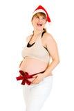 圣诞节愉快的帽子怀孕的丝带圣诞老&# 图库摄影
