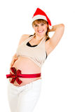 圣诞节愉快的帽子怀孕的圣诞老人妇&# 免版税库存照片