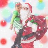 圣诞节愿望2016年 克劳斯女孩小圣诞老人 告诉愿望 库存照片