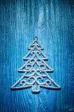 圣诞节戏弄杉树simbol在蓝色背景的 免版税库存图片