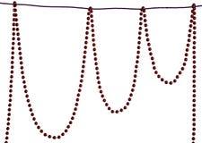 圣诞节成串珠状在白色背景的装饰 库存照片