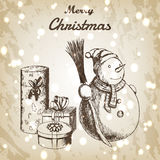 圣诞节或新年手拉的传染媒介例证 在冬天帽子的雪人有笤帚和礼物剪影的,葡萄酒样式 免版税库存图片