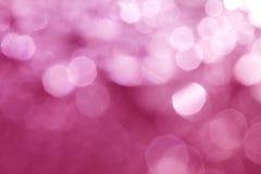 圣诞节或hol的抽象甜桃红色典雅的bokeh照明设备 库存图片