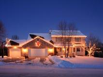 圣诞节房子点燃住宅 免版税库存图片