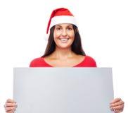 圣诞节拿着空白的标志的女商人 库存照片