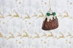 圣诞节摄影图象挂掉电话xmas布丁奶油霍莉的圣诞节装饰有驯鹿包装纸背景 免版税库存照片