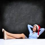 圣诞节放松的女商人 免版税图库摄影