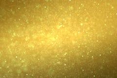 圣诞节数字式闪烁激发金黄微粒bokeh流动 库存图片