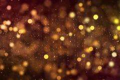 圣诞节数字式闪烁激发金黄微粒bokeh流动 免版税库存图片