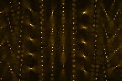 圣诞节数字式闪烁激发金黄微粒bokeh流动 图库摄影