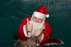 圣诞节新年度 圣诞老人衣服的滑稽的人 库存图片