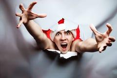 圣诞节新年概念,时髦的疯狂的人圣诞老人帽子打破t 图库摄影