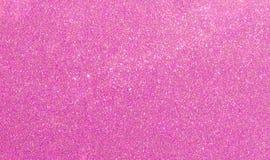 圣诞节新年紫色桃红色闪烁背景 假日抽象纹理织品 元素,闪光 免版税库存照片