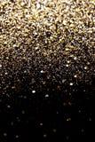 圣诞节新年黑色和金子闪烁背景 假日抽象纹理织品 免版税库存照片