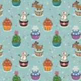 圣诞节无缝的样式用杯形蛋糕 免版税库存图片