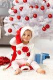 圣诞节时间的愉快的女婴 免版税库存图片