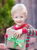 圣诞节时间的男孩 免版税库存图片