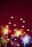 圣诞节星形点燃背景 免版税库存照片