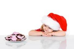圣诞节曲奇饼女孩一点时刻 免版税库存照片