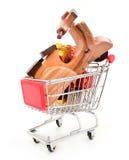 圣诞节有礼物和玩具的购物车 免版税库存照片