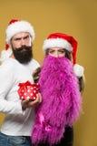 圣诞节有胡子的夫妇 库存图片