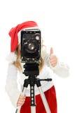 圣诞节服装的女孩与老照相机 免版税库存图片