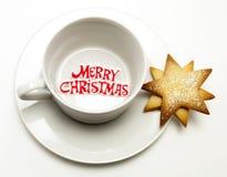 圣诞节杯子快活的茶碟 图库摄影