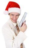 圣诞节枪快活人的帽子 库存照片