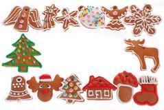 圣诞节框架用在白色隔绝的姜饼曲奇饼 图库摄影